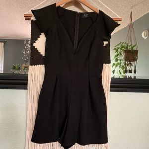 Nasty Gal black short romper deep neckline